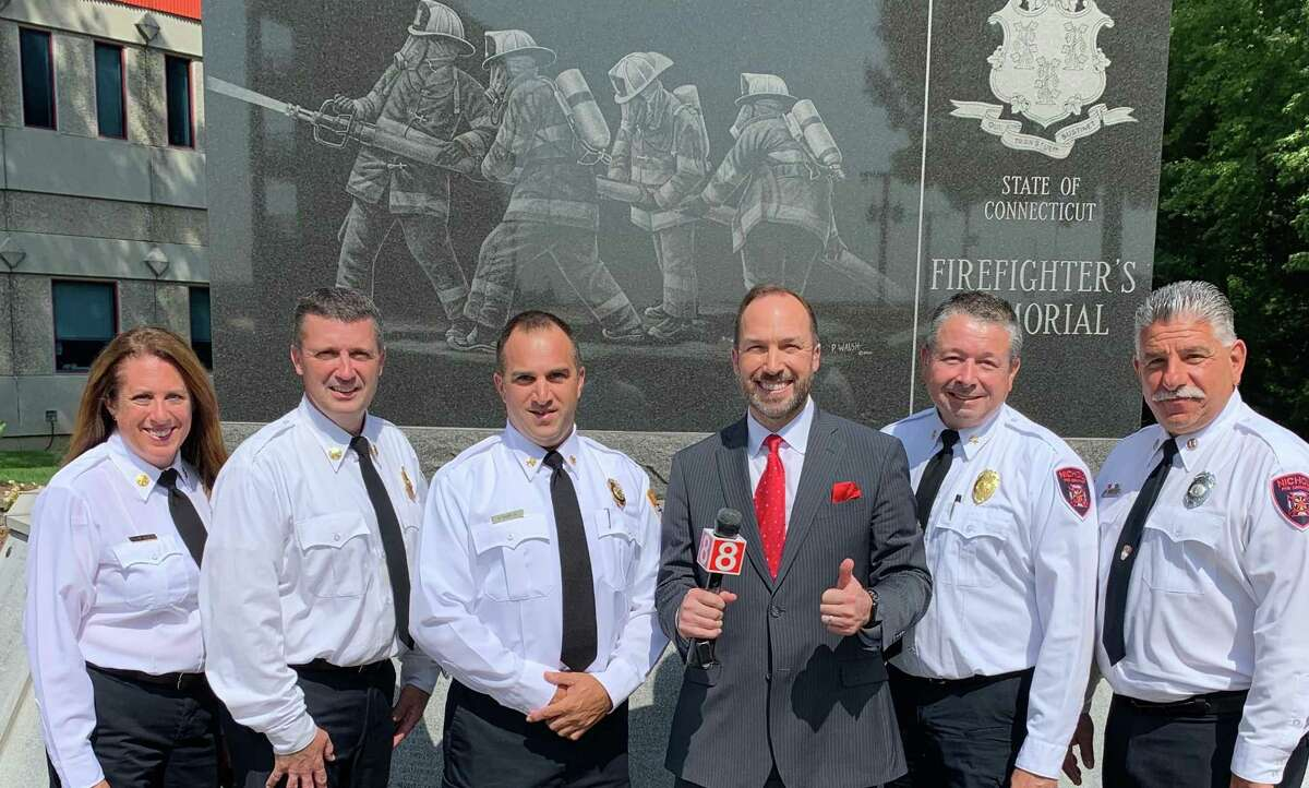 Trumbull Fire Marshal Megan Murphy, Nichols Assistant Fire Chief Ray Franko, Long Hill Fire Chief Alex Rauso, WTNH-Chief Meteorologist Gil Simmons, Nichols Fire Chief Andrew Kingsbury, and Nichols Fire Commissioner Gary Pugliese in front of the state Firefighters Memorial in 2019.