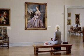 "Kim Novak sits entranced by the Portrait of Carlotta, a key plot element in the Hitchcock classic ""Vertigo."""