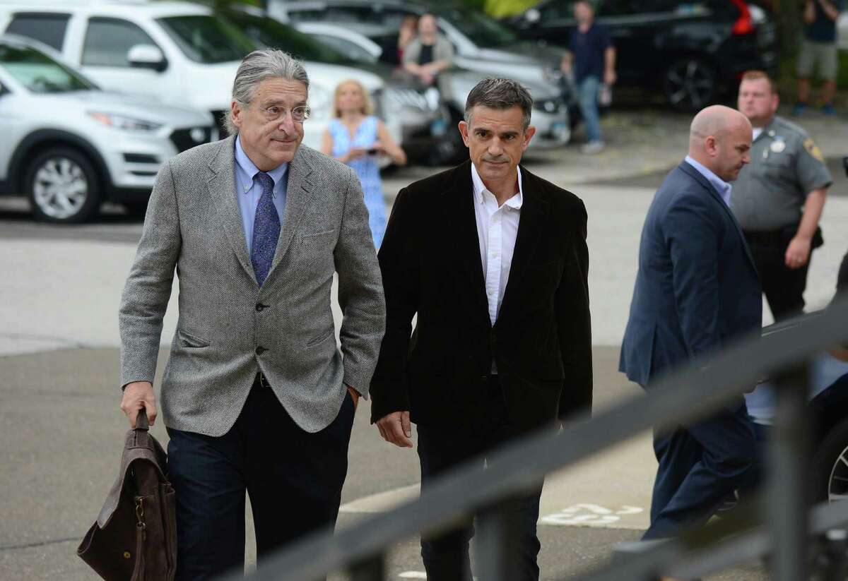 Fotis Dulos arrives with his attorney Norm Pattis Thursday at state Superior Court in Norwalk to be arraigned on a new tampering with evidence charge.
