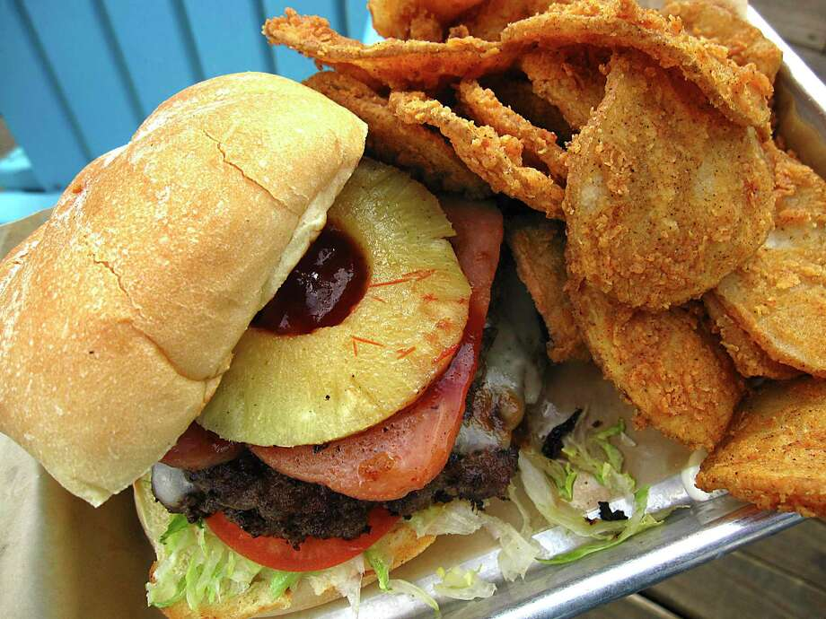 The Big Kahuna Burger includes Spam and pineapple at Lucy Cooper's Ice House. Shown with a side order of spicy breaded Rojo Fries. Photo: Mike Sutter /Staff