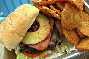 The Big Kahuna Burger includes Spam and pineapple at Lucy Cooper's Ice House. Shown with a side order of spicy breaded Rojo Fries.