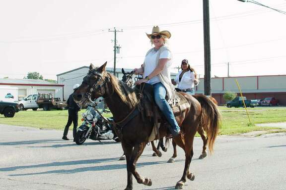 Pasadena ISD Superintendent DeeAnn Powell got into the spirit of the Pasadena Livestock Show & Rodeo in a recent trail ride to promote the event that traveled from school to school in her district. Many students in the district exhibit livestock in the annual show and compete for scholarships.