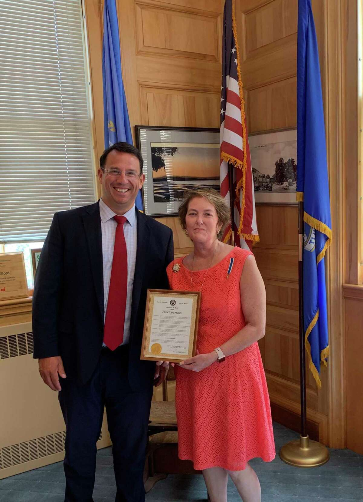 Mayor Ben Blake presented Regent Kendra Davis with a proclamation recently at Milford City Hall.