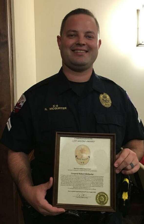 Corporal Robert McQurter of the Katy Police Department received a life-saving award at the Aug. 26 Katy City Council meeting from Police Chief Noe Diaz. Photo: Karen Zurawski / Karen Zurawski