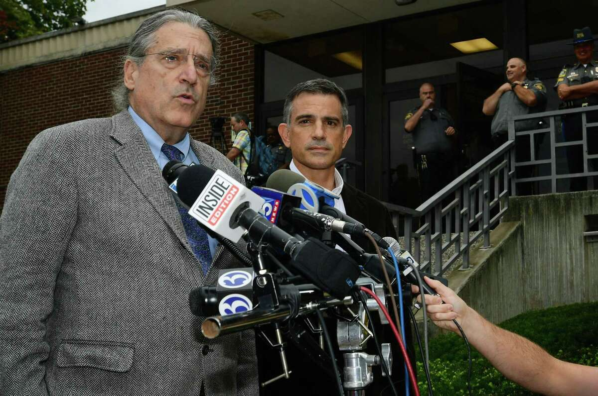 Fotis Dulos, right, appears for a press conference with his attorney Norm Pattis, left, following his arraignment on a new tampering with evidence charge Thursday, Sept. 12, 2019, at state Superior Court in Norwalk, Conn.