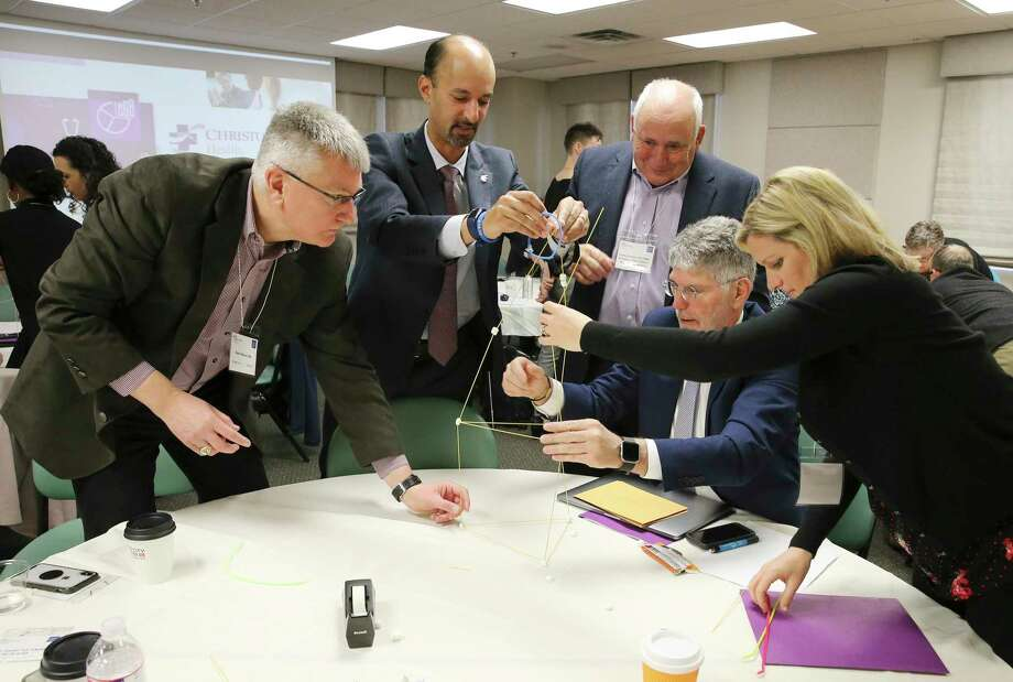 A team-building exercise as physicians gather for the first meeting regarding maternal mortality at The Children's Hospital of San Antonio Jan. 31, 2019. Photo: Kin Man Hui / San Antonio Express-News / ©2019 San Antonio Express-News