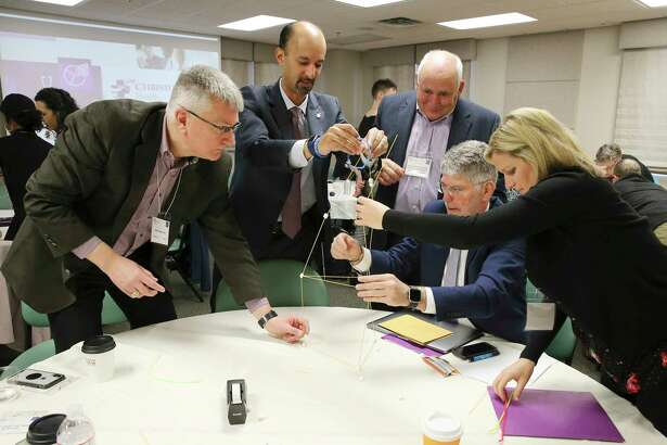 A team-building exercise as physicians gather for the first meeting regarding maternal mortality at The Children's Hospital of San Antonio Jan. 31, 2019.