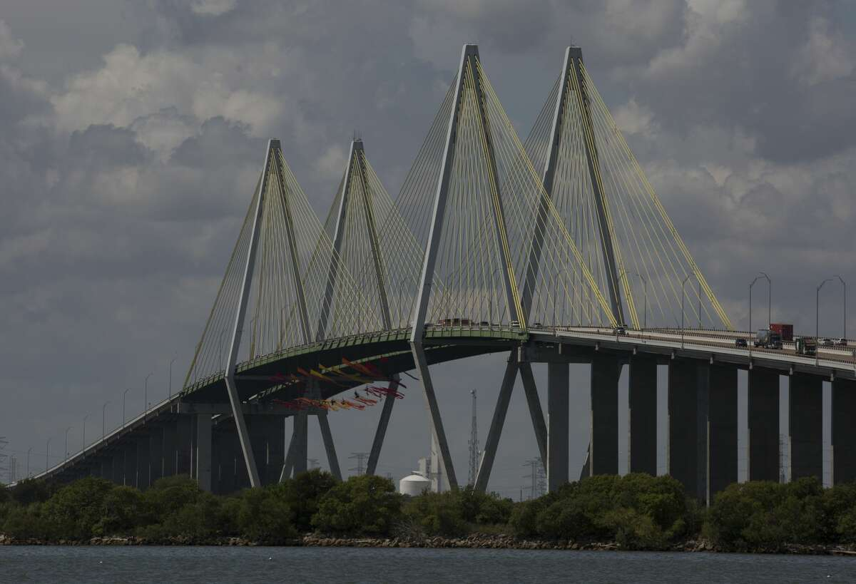 Eleven Greenpeace USA protesters are dangling from the northbound of the Fred Hartman Bridge to protest against the oil industry on Thursday, Sept. 12, 2019, in Baytown. Another 11 spotter for those protesters are sitting on the bridge. Protestors said they are intending to protest for 24 hours.