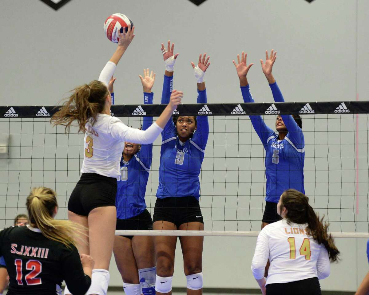 Jamilee Rassy (10), Cimone Woodard (9) and Bria Woodard (5) of Episcopal try to block a shot made by Laci Gratkowski (3) of St. John XXIII during the first set of a volleyball match between the Episcopal Knights and the St. John XXIII Lions on Friday, August 23, 2019 at Skyline Juniors, Houston, TX.
