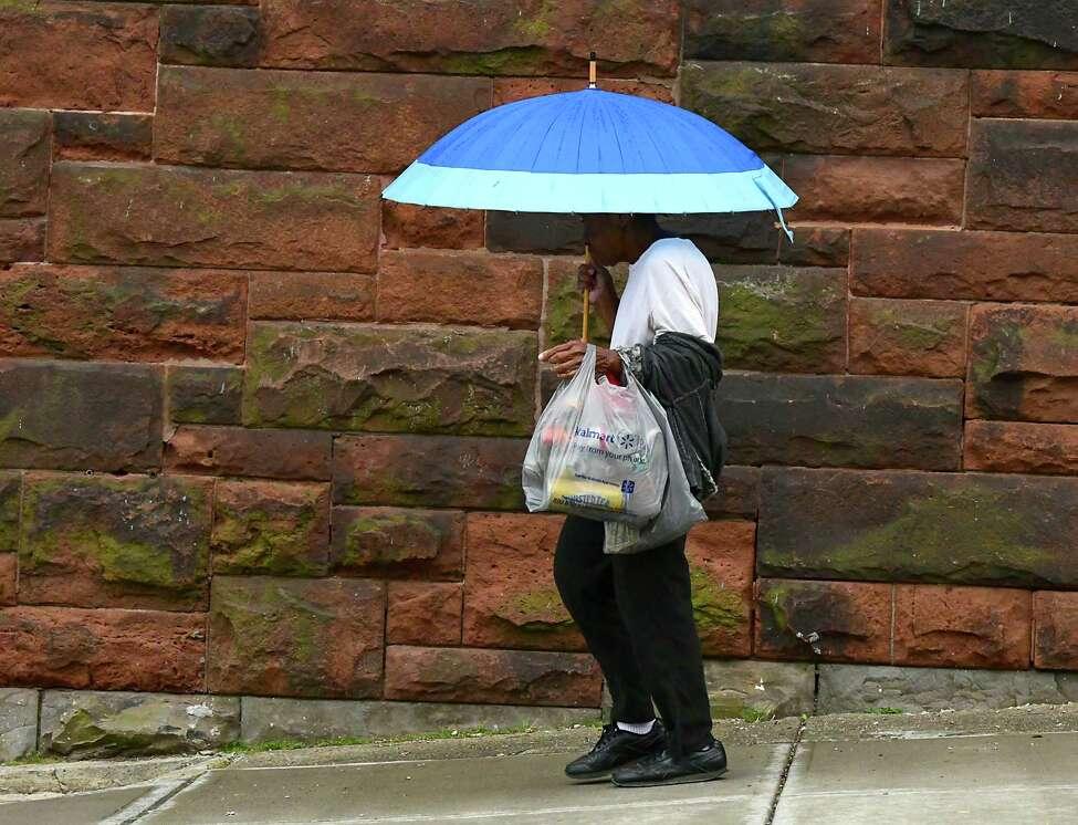 A pedestrian uses an umbrella during a light rain on Thursday, Sept. 12, 2019 in Albany, N.Y. (Lori Van Buren/Times Union)