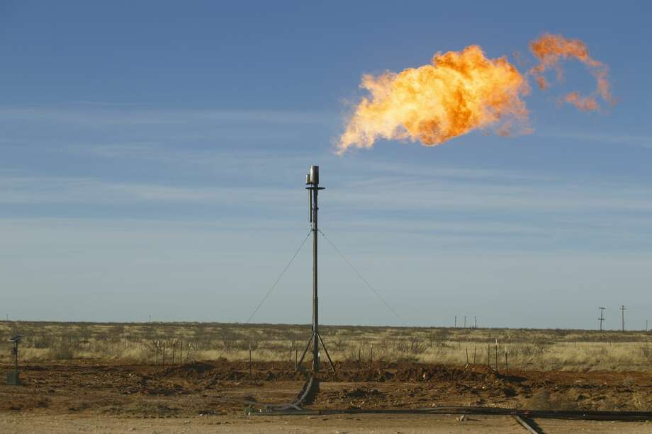 Improved takeaway capacity for Permian Basin natural gas has lifted prices out of negative territory, easing pressure on producers to flare the gas associated with their crude production, such as at this well site north of Odessa seen in 2016. Photo: MICHAEL STRAVATO/NYT