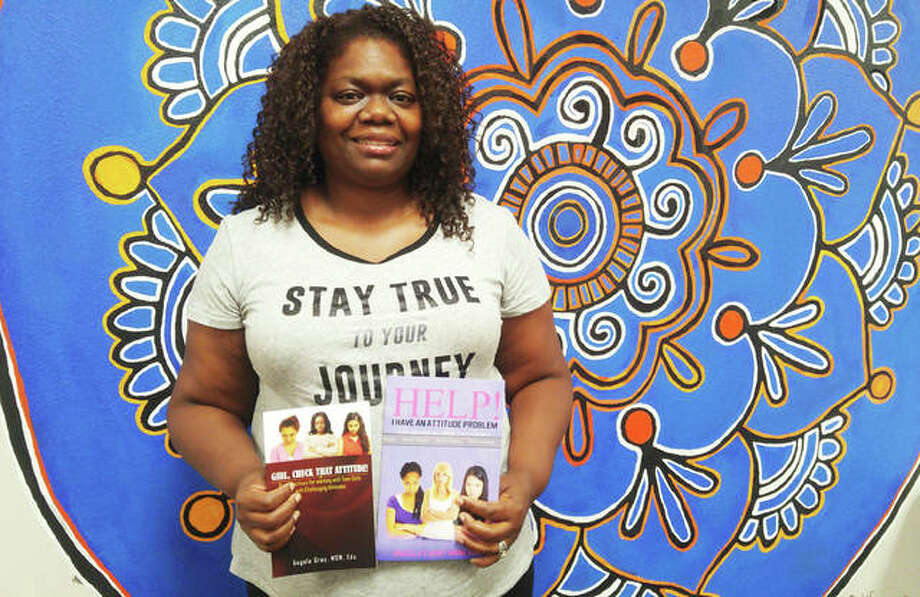 Angela Gray, a social worker at Alton High School for 17 years, finished her second book last month addressing anger issues and attitude problems among young girls. Photo: Jeanie Stephens|The Telegraph