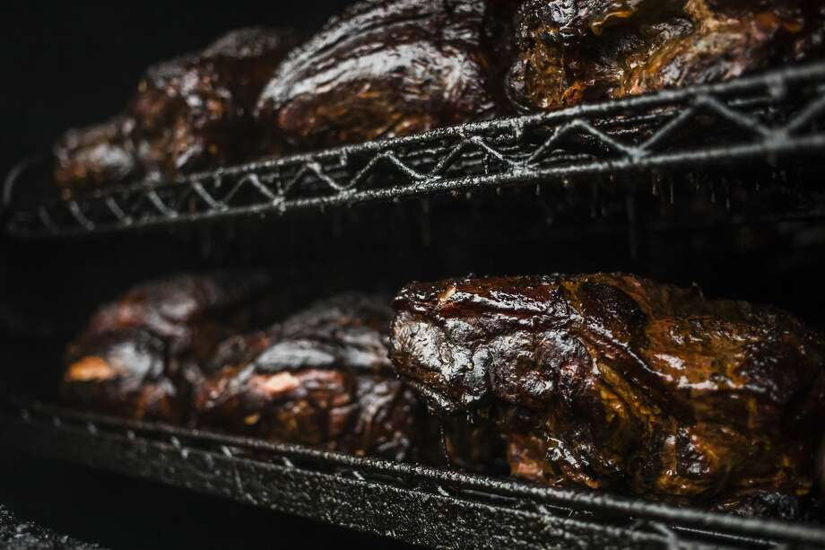 Large pieces of pork cook inside a smoker Tuesday, Sept. 10, 2019 at Bone Daddy's BBQ, located at 1900 S. Saginaw Road, suite F, in the Midland Plaza near China Palace Restaurant and Jimmy John's. The restaurant is set to re-open Tuesday, Sept. 17, 2019. (Katy Kildee/kkildee@mdn.net) Photo: (Katy Kildee/kkildee@mdn.net)