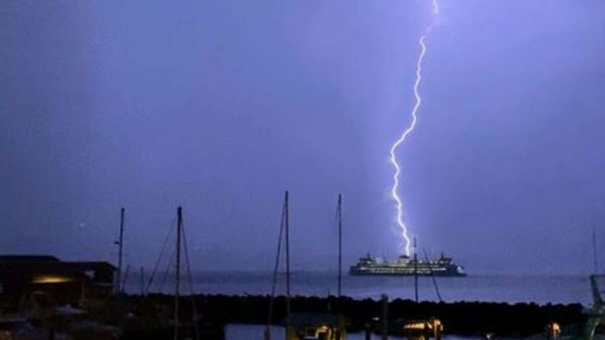 Lightning strikes behind a Washington State Ferry boat as it sailed on the Puget Sound near the Edmonds ferry dock, Sept. 7, 2019.