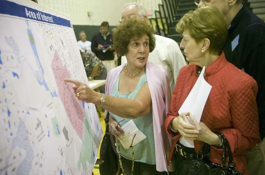 Lorraine Bowman, left, and Myrna Wunsch, both Scofieltown residents for over 30 years, look at a map of the neighborhood during a public meeting at Scofield Magnet School in Stamford, Conn. on Tuesday, Sept. 15, 2009 about possible ground water contamination in the neighborhoods around Scofiedtown Park.. Photo: Chris Preovolos / ST