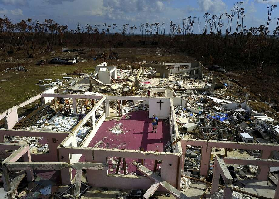 """Pastor Jeremiah Saunders pbserves the ruins of his church that was destroyed by Dorian, in High Rock, Grand Bahama. """"I spoke to the water: """"Peace, be still. It never listened,"""" he said. Photo: Ramon Espinosa / Associated Press"""