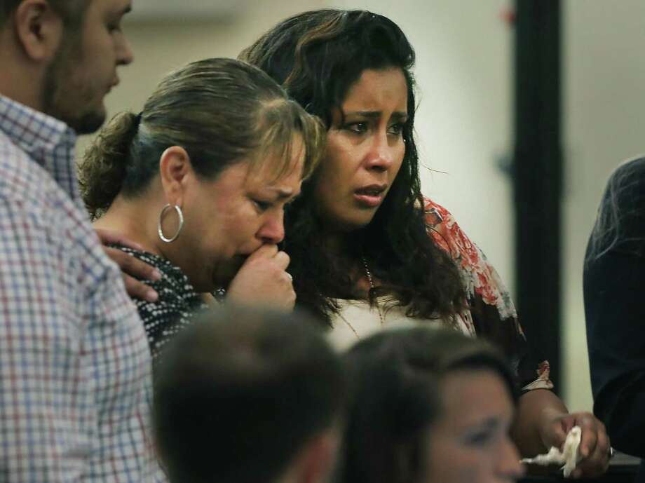 Jessica Tovar, right, wife of Edward Beltran, and Laura Acosta, his mother, face Paul Gutierrez, accused of killing Beltran, on Tuesday. They provided victim impact statements before Gutierrez was led out of the courtroom. Prosecutor Kaitlin Knowles read Acosta's statement. Photo: Bob Owen /Staff Photographer / ©2019 San Antonio Express-News