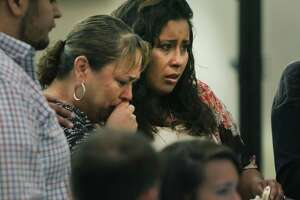 Jessica Tovar, right, wife of Edward Beltran, and Laura Acosta, his mother, face Paul Gutierrez, accused of killing Beltran, on Tuesday. They provided victim impact statements before Gutierrez was led out of the courtroom. Prosecutor Kaitlin Knowles read Acosta's statement.