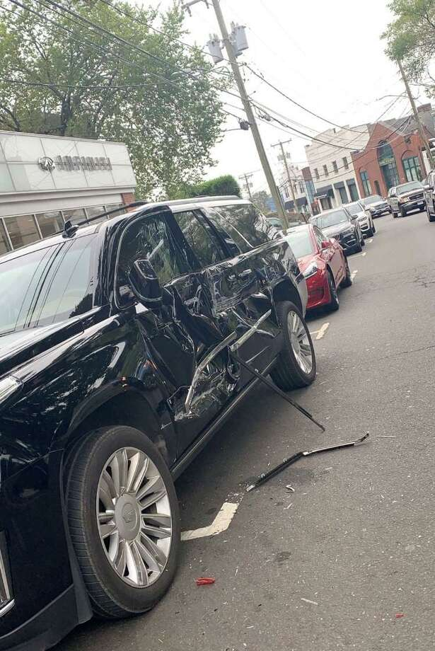 A Cadillac was badly damaged on Milbank Avenue Tuesday morning after it was hit by a truck. Photo: / Contributed