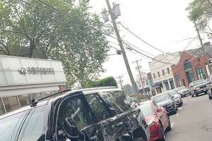 A Cadillac was badly damaged on Milbank Avenue Tuesday morning after it was hit by a truck.