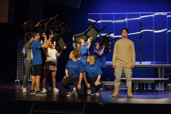 """Friendswood High School students rehearse a scene from their original spoken-word play, """"White Noise."""""""