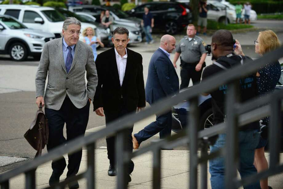 Fotis Dulos, center, arrives with his attorney Norm Pattis, left, for arraignment on a new tampering with evidence charge Thursday, September 12, 2019, at state Superior Court in Norwalk, Conn. Photo: Erik Trautmann / Hearst Connecticut Media / Norwalk Hour