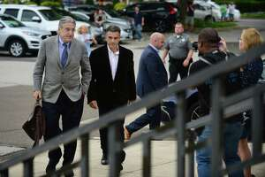 Fotis Dulos, center, arrives with his attorney Norm Pattis, left, for arraignment on a new tampering with evidence charge Thursday, September 12, 2019, at state Superior Court in Norwalk, Conn.