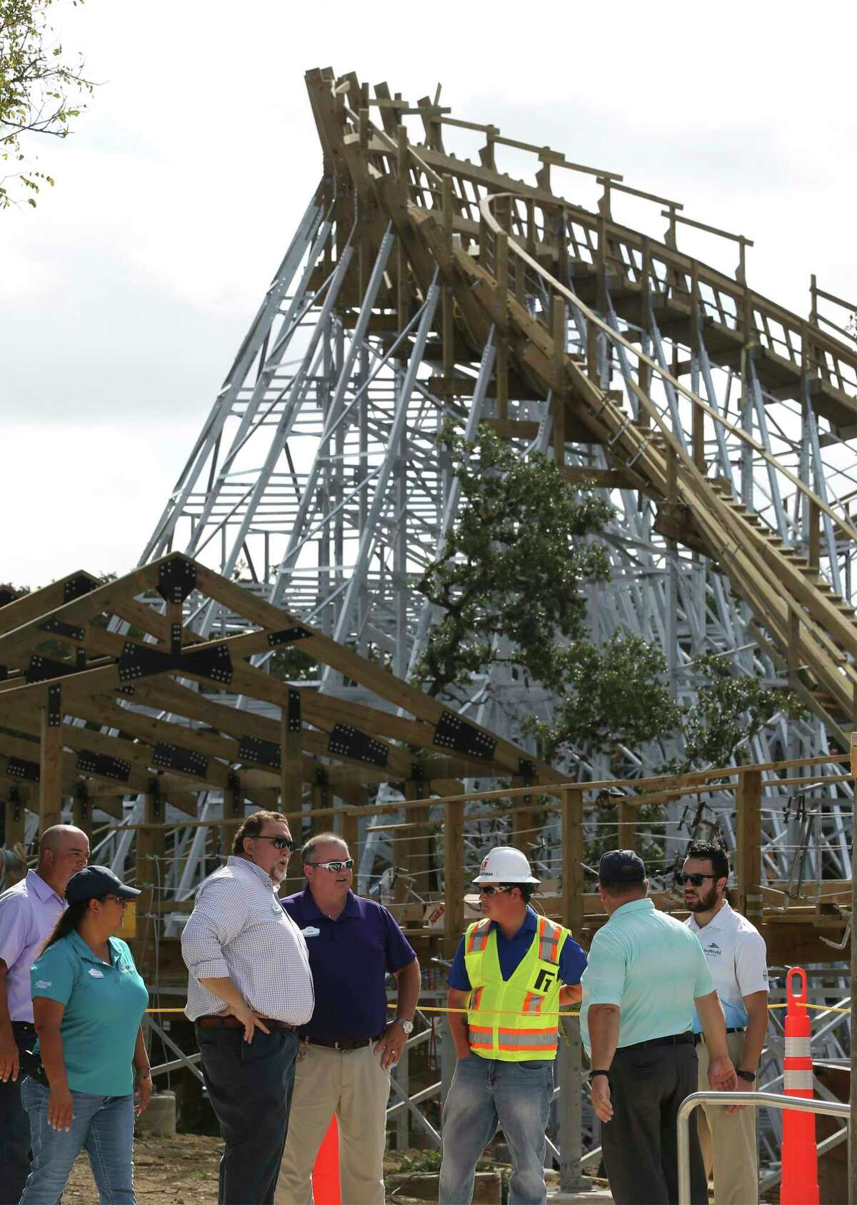 SeaWorld San Antonio officials stand near the construction of their latest upcoming thrill ride, Texas Stingray, during a press conference on Thursday, Sept. 12, 2019. The Texas Stingray is a roller coaster with wooden tracks with steel supports and zips riders around at 55 miles per hour. There are steep 76-degree banks and a 100-foot drop to titillate thrill riders. Especially unique is the minimum rider height is 46 inches which give younger thrill seekers the opportunity to get on the coaster. Texas Stingray is still under construction and is expected to open to guests by spring 2020 according to officials. (Kin Man Hui/San Antonio Express-News)