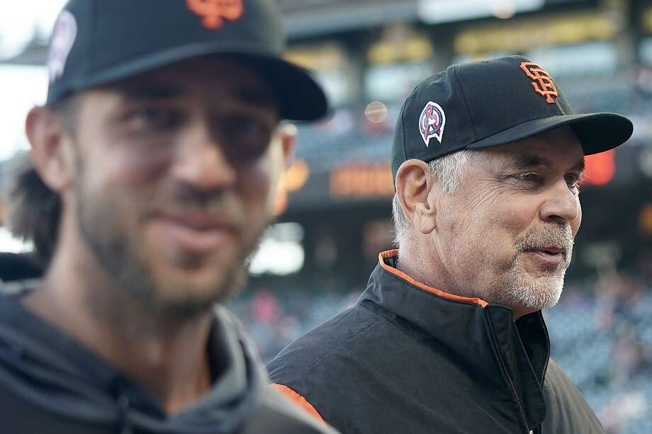 San Francisco Giants manager Bruce Bochy, right, walks back to the dugout with pitcher Madison Bumgarner after the national anthem during a baseball game against the Pittsburgh Pirates Wednesday, Sept. 11, 2019, in San Francisco. Bochy announced that Bumgarner would not be pitching in the Giants regular season finale Sunday. Photo: Tony Avelar / Associated Press