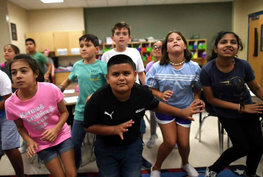 Luis Fabela, center, dances with classmates in fifth grade classroom at Ellison Elementary School. Luis transferred earlier this year to Ellison, where the dual language program hasn't yet reached fifth grade. Luis was placed in a class with bilingual students so he'd continue to learn Spanish. Photo: Billy Calzada / Billy Calzada