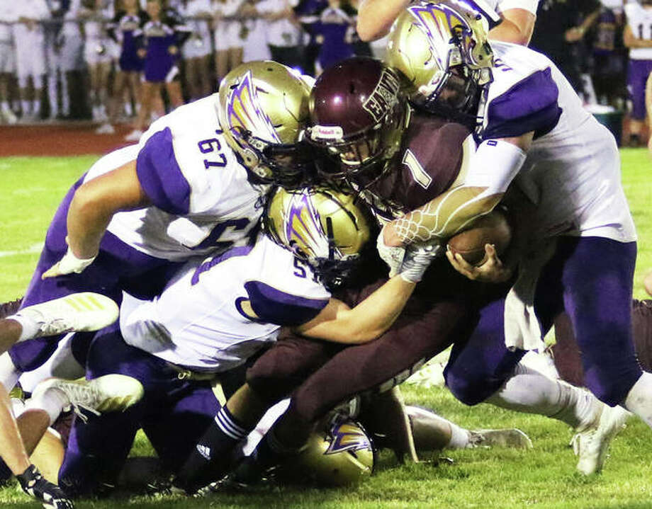 EA-WR's Brendan Noel (1) is taken down by CM defenders during a Week 2 game in Wood River. EA-WR is back home Friday to play Madison, while CM welcomes Cahokia to Bethalto. Photo: Greg Shashack / The Telegraph