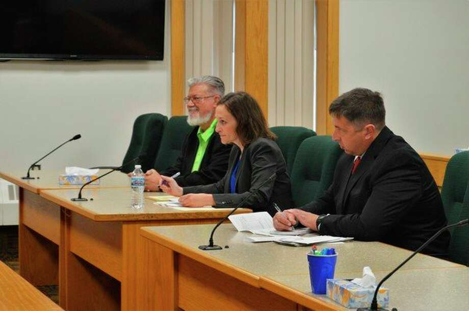 From left, Midland Councilman Marty Wazbinski, Attorney Sara Eastman and Midland resident Arthur Bach appear at the Midland County Courthouse on Thursday for a clarity hearing regarding a recall petition that Bach filed against Wazbinski. (Ashley Schafer/Ashley.Schafer@hearstnp.com)