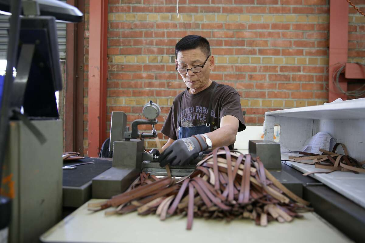 A worker at Circa of America, one of the largest manufacturers of leather goods. The company is closing its Bayview plant, laying off workers and moving its HQ to Atlanta.