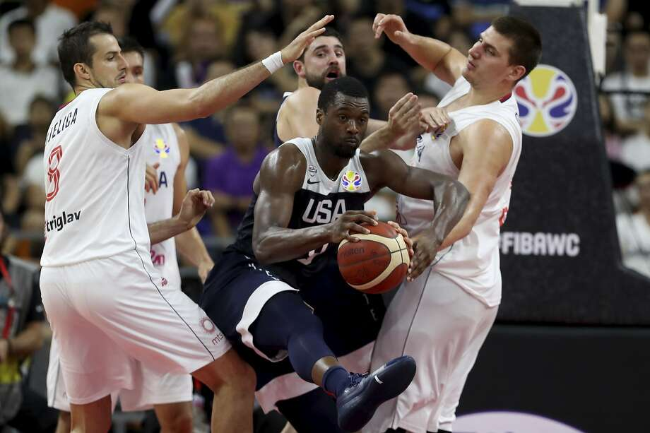 United States' Harrison Barnes try to break through Serbia's players during a consolation playoff game for the FIBA Basketball World Cup in Dongguan in southern China's Guangdong province on Thursday, Sept. 12, 2019. The U.S. will leave the World Cup with its worst finish ever in a major international tournament, assured of finishing no better than seventh after falling to Serbia 94-89 in a consolation playoff game on Thursday night. (AP Photo/Ng Han Guan) Photo: Ng Han Guan, Associated Press