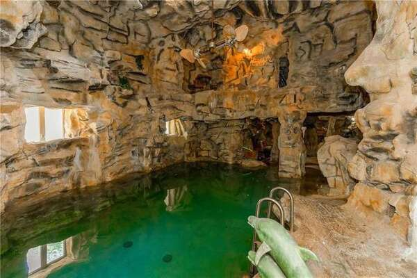 Underneath the $11.8 million manse in Lake Quivira, KS, is a network of scuba diving tunnels carved more than 30 feet deep into the mountain.