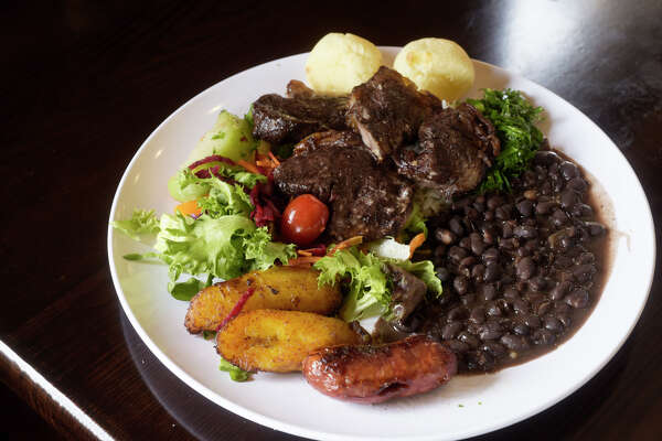 A view of a plate of food from the buffet at the Brazilian Steakhouse on Central Ave. on Thursday, Sept. 5, 2019, in Colonie, N.Y. The plate is filled with picanha steak, Brazilian pork sausage, rice, beans, cheese bread, fried plantain, fresh vegetables and fresh salad. (Paul Buckowski/Times Union)