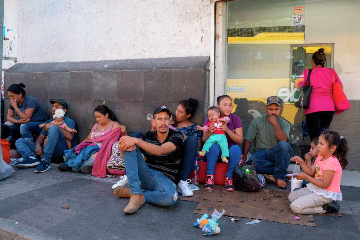 Migrants, mostly from Mexico, are pictured sitting on the ground waiting near the Paso del Norte Bridge at the Mexico-US border, in Ciudad Juarez, Mexico, on September 12, 2019. - The US Supreme Court on September 11, 2019, allowed asylum restrictions by President Donald Trump's administration to take effect, preventing most Central American migrants from applying at the US border. (Photo by Paul Ratje / AFP)PAUL RATJE/AFP/Getty Images