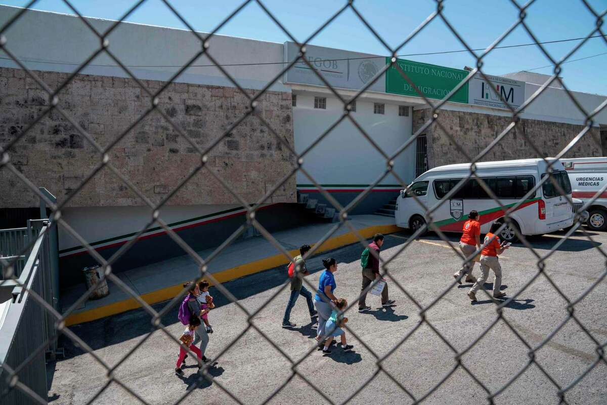Migrants are led out of the National Institue of Migration in downtown Ciudad Juarez, Mexico, near the Mexico-US border, on September 12, 2019. - The US Supreme Court on September 11, 2019, allowed asylum restrictions by President Donald Trump's administration to take effect, preventing most Central American migrants from applying at the US border. (Photo by Paul Ratje / AFP)PAUL RATJE/AFP/Getty Images