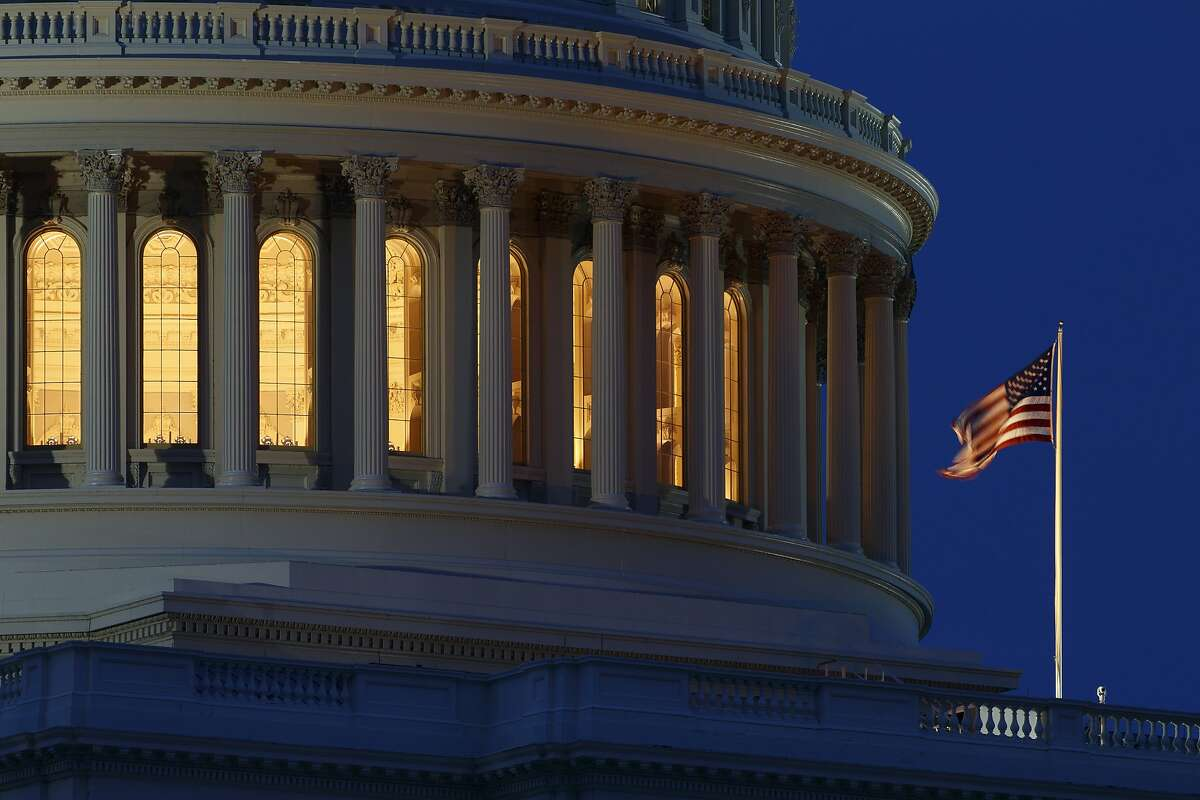 FILE - In this July 16, 2019, file photo an American flag flies on the Capitol Dome in Washington. On Thursday, Sept. 12, the Treasury Department releases federal budget data for August. (AP Photo/Carolyn Kaster, File)