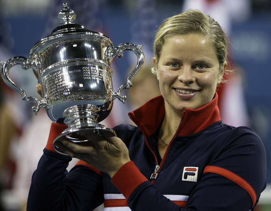 FILE - In this Sept. 13, 2009, file photo, Kim Clijsters holds the trophy after winning the women's championship over Caroline Wozniacki, at the U.S. Open tennis tournament in New York. Four-time Grand Slam champion Kim Clijsters is planning another comeback. A mother of three, the Belgian who retired after the 2012 U.S. Open wants a new challenge, she told the WTA in an interview on its website on Thursday, Sept. 12, 2019. (AP Photo/Charles Krupa, FIle) Photo: Charles Krupa / Associated Press