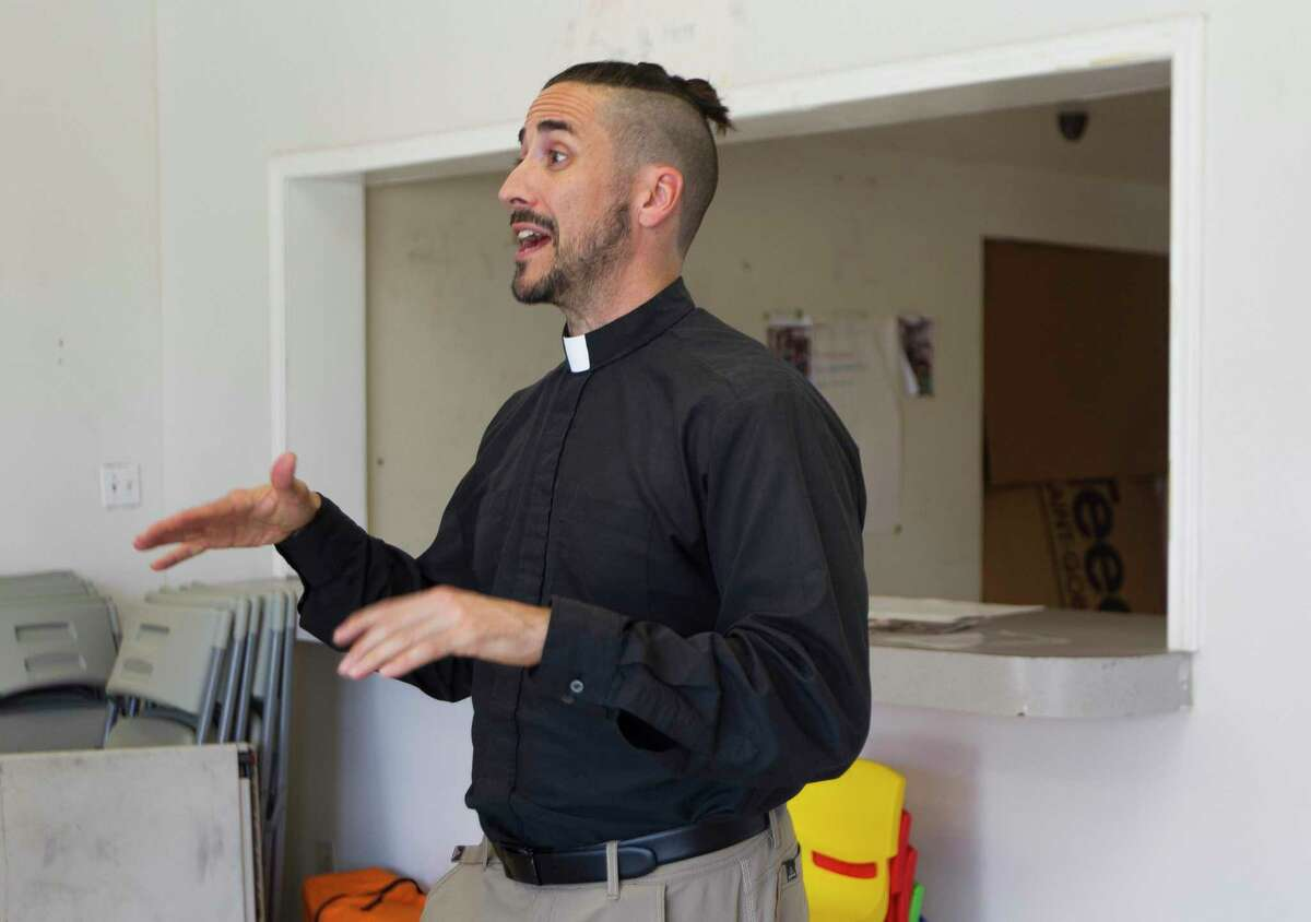 Sean Steele, reverend of St. Isidore Episcopal Church, gives a tour of the church's food pantry and event space the organization is renovating from a former industrial space, Wednesday, Sept. 11, 2019, in Spring.