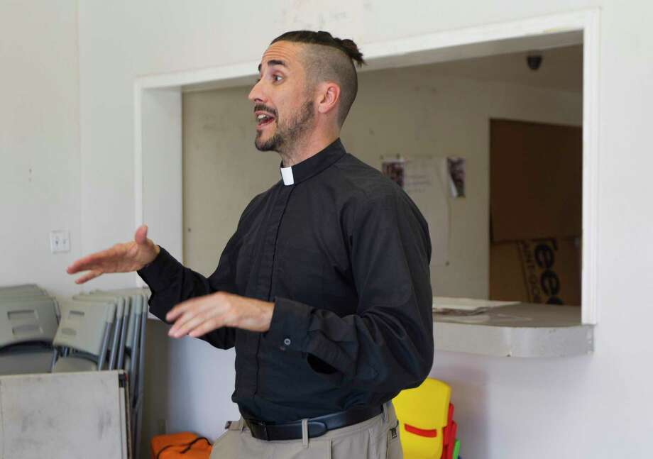 Sean Steele, reverend of St. Isidore Episcopal Church, gives a tour of the church's food pantry and event space the organization is renovating from a former industrial space, Wednesday, Sept. 11, 2019, in Spring. Photo: Jason Fochtman, Houston Chronicle / Staff Photographer / Houston Chronicle