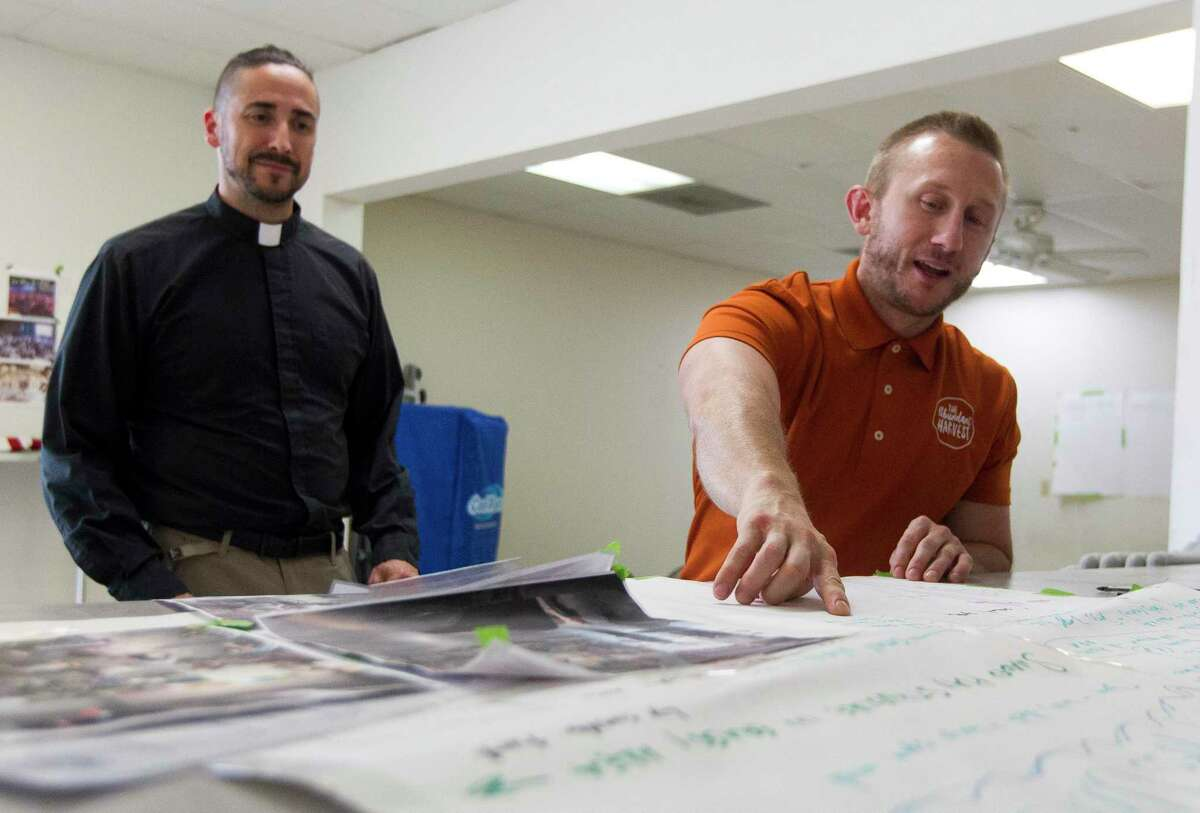 Jeremy Hall, right, talks about St. Isidore Episcopal Church's plan for a recently purchases industrial space beside Reverend Sean Steele, Wednesday, Sept. 11, 2019, in Spring.
