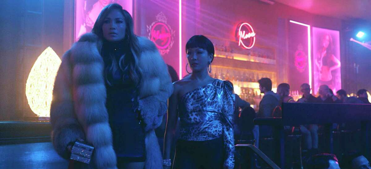 This image released by STXfilms shows Jennifer Lopez, left, and Constance Wu in a scene from