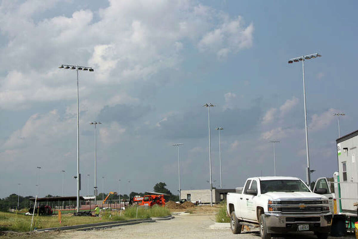 Some of the parking lot lights have been erected at Plummer Family Park. City officials say paving should begin within the next week. In the left background are the light standards for the three soccer fields with synthetic turf.