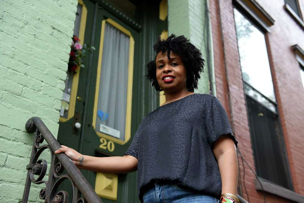 Sherisa Moore, an aspiring doula, is pictured outside the Family Life Center on Thursday, Sept. 12, 2019, on Elm Street in Albany, N.Y. Doulas are professionals who support women through pregnancy, birth and postpartum by educating and advocating for them. (Will Waldron/Times Union)