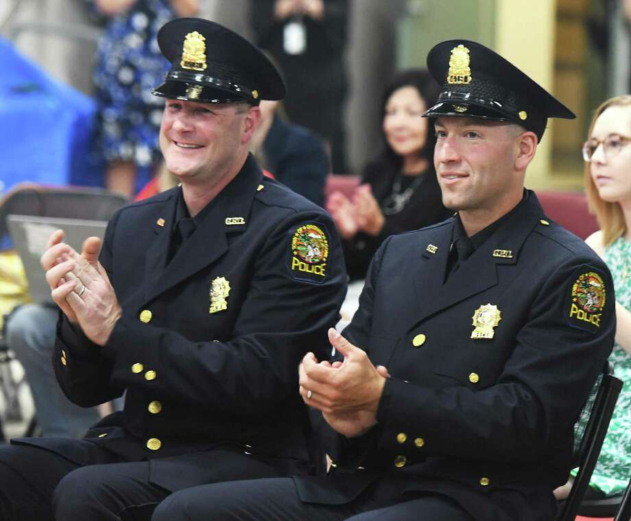 New Greenwich Police Sergeants Craig Zottola, left, and James Ruszkowski Jr. applaud during the a promotion ceremony in Greenwich, Thursday. 12, 2019. Greenwich Police Detectives Craig Zottola and James Ruszkowski Jr. were both promoted to the rank of Sergeant. Photo: Tyler Sizemore / Hearst Connecticut Media / Greenwich Time