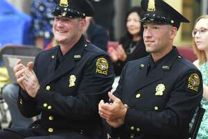 New Greenwich Police Sergeants Craig Zottola, left, and James Ruszkowski Jr. applaud during the a promotion ceremony in Greenwich, Thursday.   12, 2019. Greenwich Police Detectives Craig Zottola and James Ruszkowski Jr. were both promoted to the rank of Sergeant.