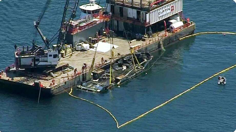 This photo from video provided by NBC/LA shows the burned hulk of the Conception being brought to the surface by a salvage team off Santa Cruz Island in the Santa Barbara Channel in Southern California Thursday, Sept. 12, 2019. The vessel burned and sank on Sept. 2, taking the lives of 34 people aboard. Five survived. (NBC/LA via AP) Photo: Associated Press