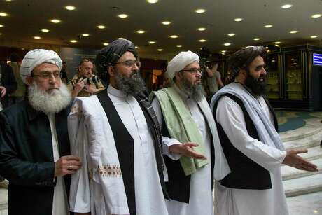 Mullah Abdul Ghani Baradar, the Taliban's top political leader, second left, and other members of the Taliban delegation met in May for talks in Russia. President Donald Trump recently nixed a planned meeting with the Taliban at Camp David.